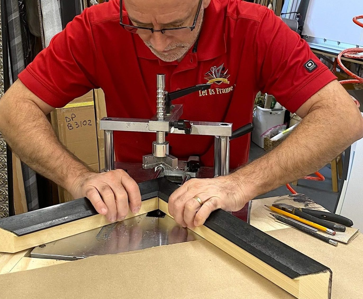 Image shows a corner of a custom frame being assembled using the underpinner machine.